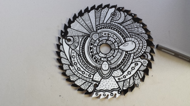 Saw Blade #2 by MuscularTeeth. Ink on Steel.